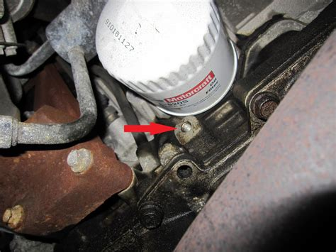 Taurus-Question Where Is The Oil Filter On A 2003 Ford Taurus.