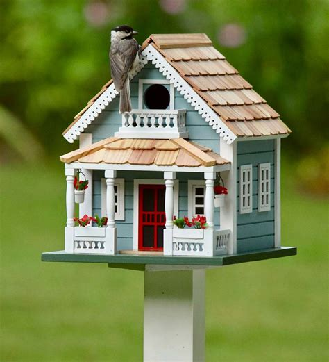 white bird house on pole