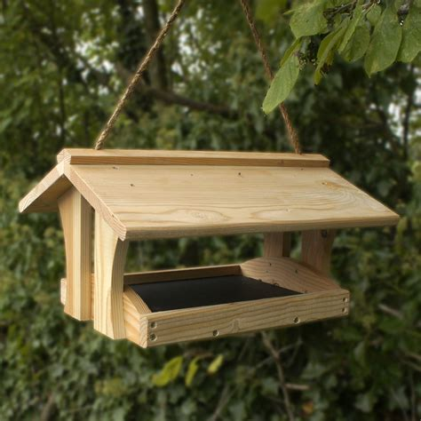 wooden post for bird feeders