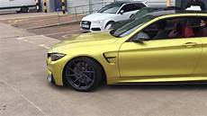 bmw m4 with akrapovic exhaust downpipes lowered on
