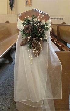 pew swag with ivory organza pine cones pine greens and pew swag with ivory organza pine cones pine greens and