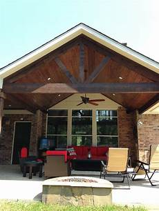 gable roof patio cover attached to existing house with cedar beams and posts and stained