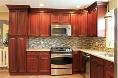 cherry kitchen cabinets tile backsplash