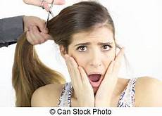 girl doubting about haircut hairdresser cutting very long hair while female model is doubtful