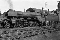 a3 locomotive names grantham shed staff with 60112 st simon tracks through grantham