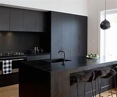 Black Kitchen - a matte black kitchen makes a bold statement in this auckland villa