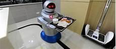 chine un restaurant tenu par des robots le point