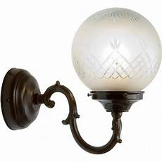 traditional wall light with patterned glass globe shade