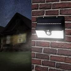 solar powered outdoor wall lights daylight white batteries included le 174