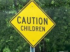 warning sign caution children streetsign catholic