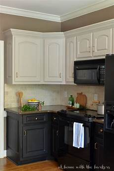 kitchen paint colors with white cabinets and black appliances black kitchen cabinets the at home with the barkers