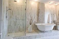 great bethroom done in calcutta porcelain tile that looks