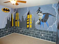 batman room makeover started with blue walls brick is painted throughout the bottom border of