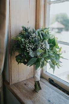 beautifully romantic wedding on a diy budget gypsophila eucalyptus and thistle foliage wedding