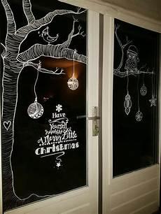 christmas window decoration with chalk weihnachtsfenster