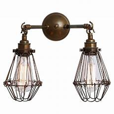 brass wall light with cage shade create an industiral
