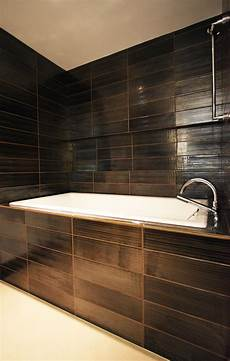 bathroom remodel tile ideas pair of remodeled condo bathrooms transforms the nondescript into an expression of owner s