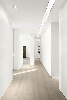 white walls and in floor storage make this creative house design grey wash wood floors white walls our house living