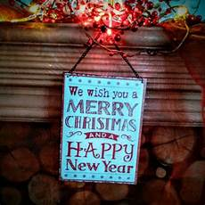 we wish you a merry christmas and a happy new year hanging metal sign
