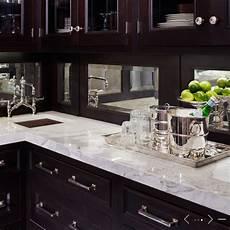 mirror backsplash traditional kitchen de giulio