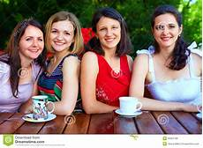beautiful friends in summer cafe stock photo
