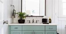love this minty almond green cabinet the marble sink with black framed mirror white
