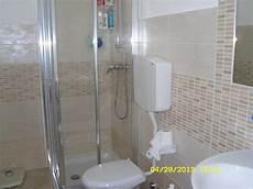 costo costruzione bagno foto bagno completo con rivestimento moderno opaco di
