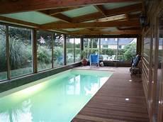 piscine interieur exterieur em port blanc grande casa quente de madeira piscina