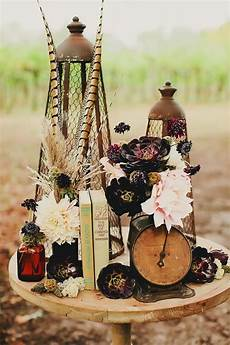 a wedding centerpiece with vintage books an clock stunning peonies and succulents