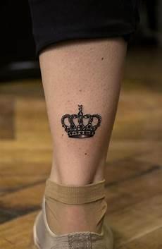 beautiful crown tattoo on leg calf