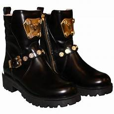 versace black and gold boots