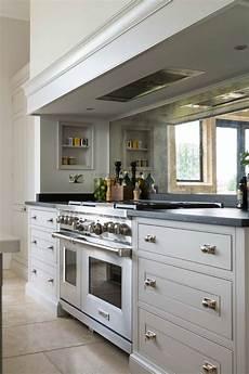 Mirror Backsplash In Kitchen