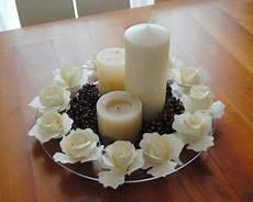come decorare candele centrotavola con di carta pigne e candele