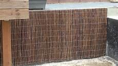 mauer mit holz verkleiden mit weidenmatten eine betonmauer verkleiden