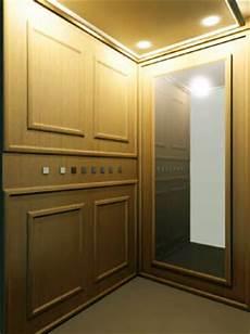 cornici in legno per pareti cabine ascensori elfer