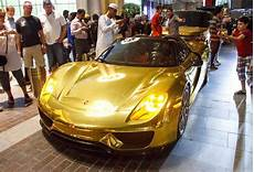 Automobile In Dubai by Gold Car Bonanza In Dubai 918 G63 6x6 Aventador Range