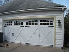 Chi Garage Doors 5217 by Model 2216 In Bronze With Optional Sunburst Window Inserts