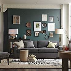 Wandfarbe Petrol Grau - teal colored accent wall in living room with grey