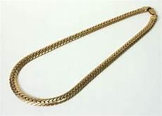collier en or jaune a maille serpent poincon tete daigle