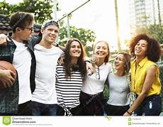 smiling happy friends arms around shoulder outdoors stock image image of concept