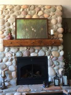 should i put a shinny sealant my river rock fireplace
