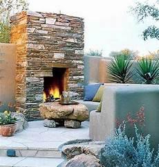 kamin im garten veranda mit naturstein gestalten garten kamin feuerstelle