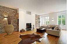 wohnzimmer design beispiele the interior of a living room in brown color features
