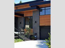 gray brick, black trim, cedar siding   home sweet