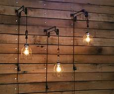 pulley wall with industrial wooden handle cage light
