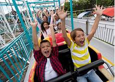 very happy kids fun a rollercoaster at an amusement park download image
