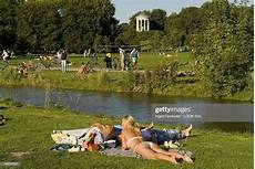 englischer garten fkk sunbathing at eisbach in front of monopteros