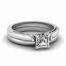 asscher cut diamond cathedral wedding ring set in 950