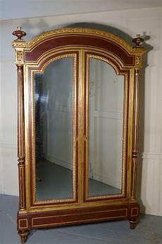 a glamorous deco gold burgundy armoire