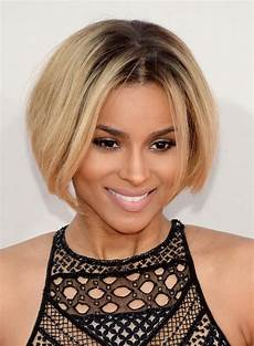 ciara rounded short bob hairstyle with dark roots for